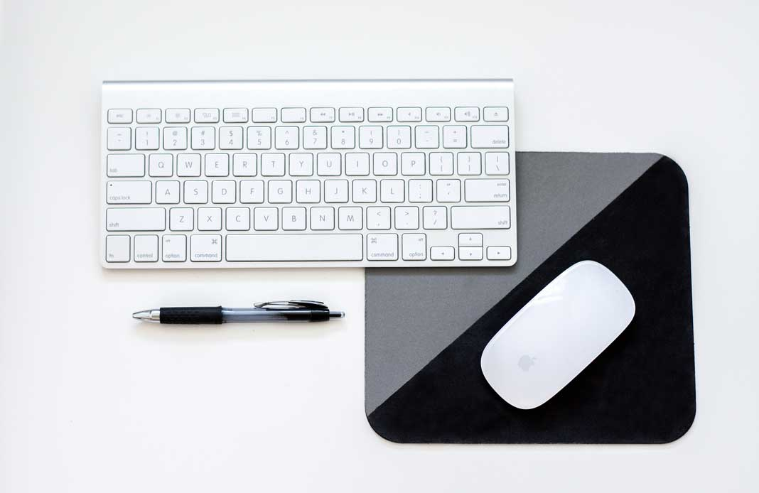 Apple keyboard and mouse shot from above